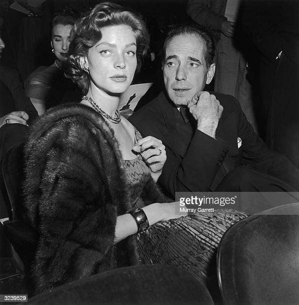 EXCLUSIVE Married American actors Lauren Bacall and Humphrey Bogart wear formal evening clothes while seated at the Academy Awards RKO Pantages...