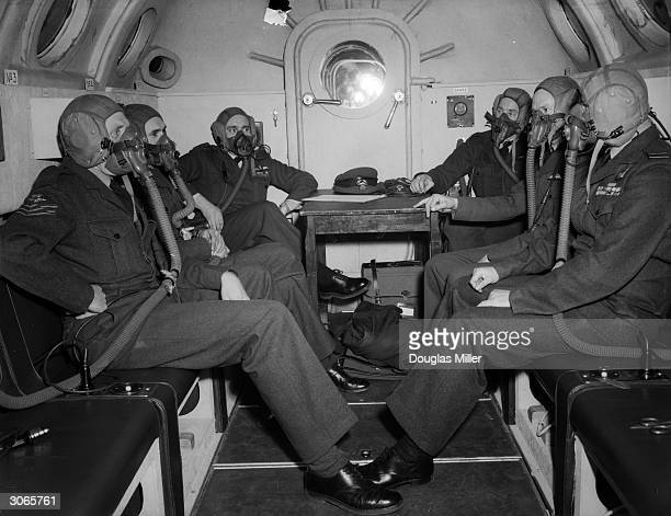 The pilots of Britain's first atomic bomb squadron experience the effects of highaltitude flying in a special decompression chamber at the RAF base...
