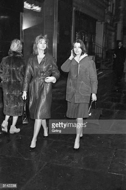 Callgirls Mandy RiceDavies and Christine Keeler who became famous for their controversial involvement with war minister John Profumo which eventually...