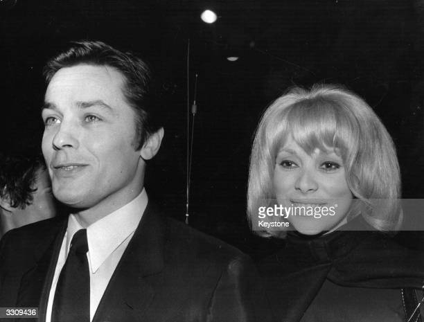 Alain Delon, the French actor and producer at the premiere of his latest film 'Borsalino,' with his partner in the film, French actress Mirielle...