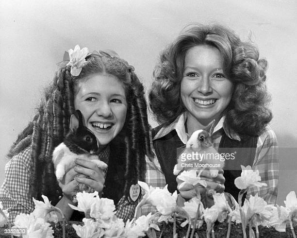 Stage and television personalities Bonnie Langford and Lena Zavaroni with two pet rabbits.