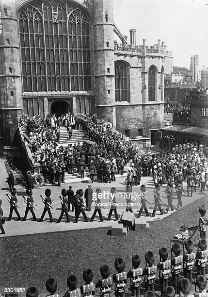The coffin of King Edward VII is carried into St George's Chapel at Windsor