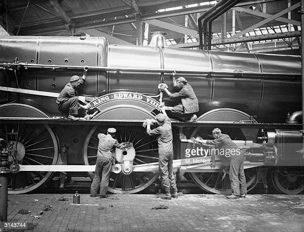 Workmen prepare the King Edward VIII Great Western Railway engine for service