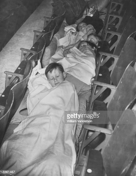 Young Dutch and Belgian refugees sleeping in the seats at Empress Stadium in Earl's Court, London.