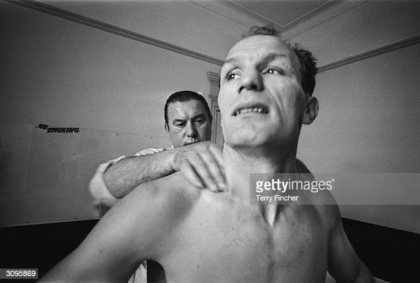 English boxer Henry Cooper being given a massage.