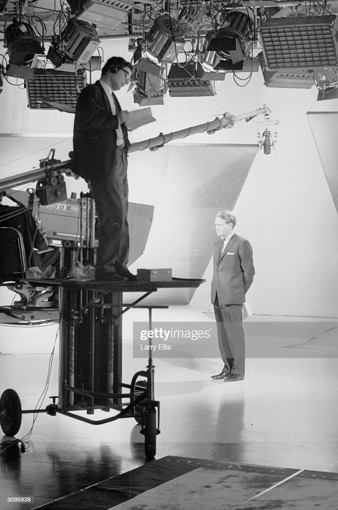 Former olympic athlete and Conservative politician Chris Chataway in a television studio.