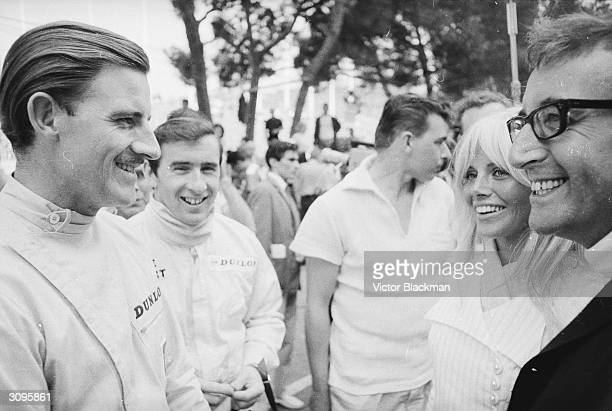 Swedish actress Britt Ekland and her husband Peter Sellers at the Monaco grand prix talking with the English racing driver Graham Hill and his...
