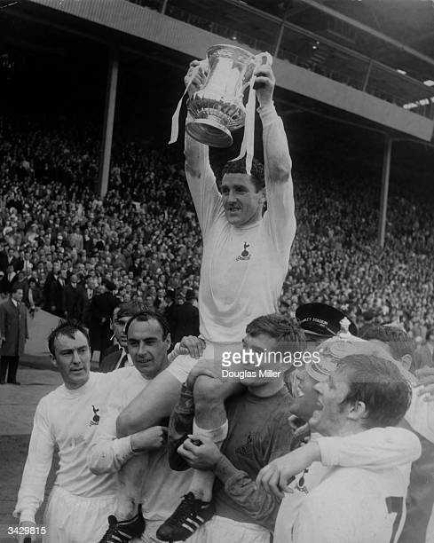 Dave Mackay the captain of Tottenham Hotspur celebrating with his teammates Jimmy Greaves Alan Gilzean Pat Jennings Terry Venables and Jimmy...