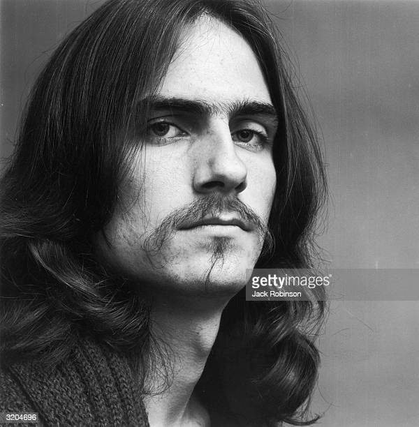 Headshot portrait of American folk musician James Taylor.