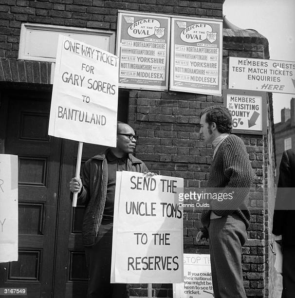 Peter Hain leader of the Young Liberals and member of the 'Stop the Tour 1970' committee talks to a fellow antiapartheid demonstrator outside Surrey...