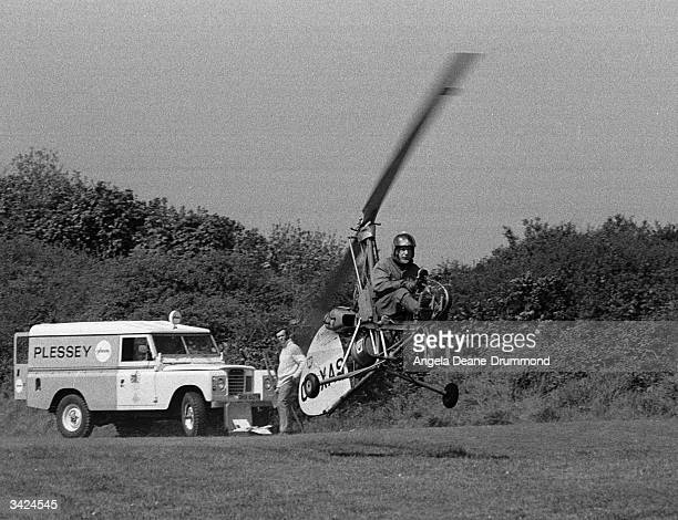 Wing Commander Wallis landing his Wallis autogiro during the Police search for the missing Lord Lucan