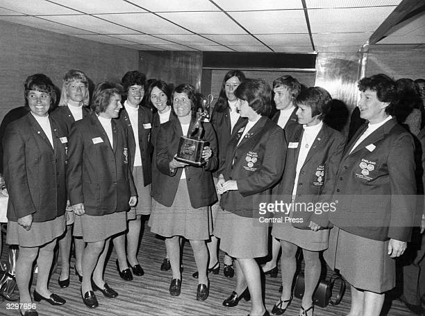 Rachel HeyhoeFlint captain of the England women's cricket team holding the trophy which will be presented to the winners of the match against...