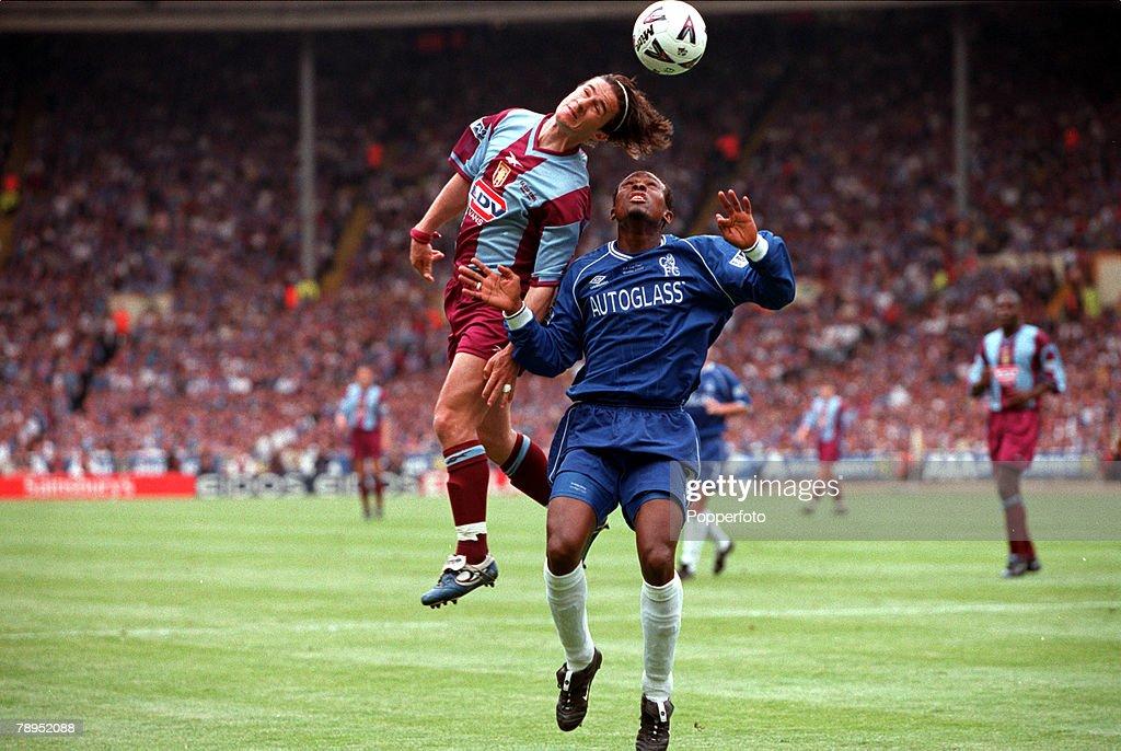 20th May 2000. Wembley, London. AXA FA Cup Final. Chelsea 1 v Aston Villa 0. Aston Villa's Benito Carbone outjumps Chelsea's Celestine Babayaro. : News Photo
