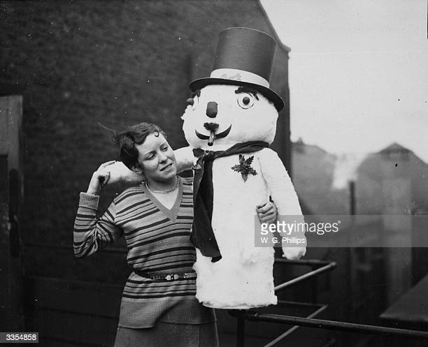A young girl with a toyfilled snowman at Messrs Pascalls in Blackfriars London