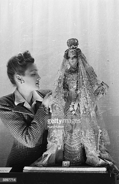 Cuban doll wearing traditional wedding dress 'Pearl of the Antilles' From the exhibition of fashion designer Norman Hartnell's collection of dolls...