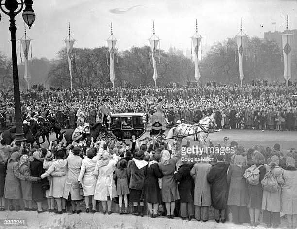 After the wedding ceremony Princess Elizabeth and Prince Philip return to Buckingham Palace London with their escort of the Household Cavalry