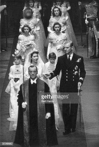 Princess Elizabeth and Prince Philip make their way down the aisle of Westminster Abbey London on their wedding day Original Publication Picture Post...