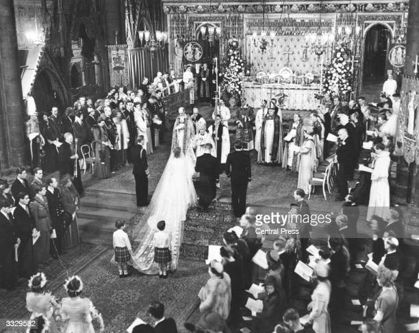 Princess Elizabeth and Prince Philip receiving the blessing of the Archbishop of Canterbury as they kneel on the steps of the sanctuary in...