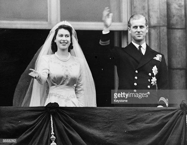 Princess Elizabeth and The Prince Philip Duke of Edinburgh waving to a crowd from the balcony of Buckingham Palace London shortly after their wedding...