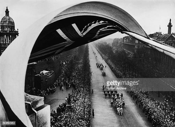 Princess Elizabeth is driven along the Mall to Westminster Abbey in the Irish Coach with a sovereign's escort of the Household Cavalry for her...
