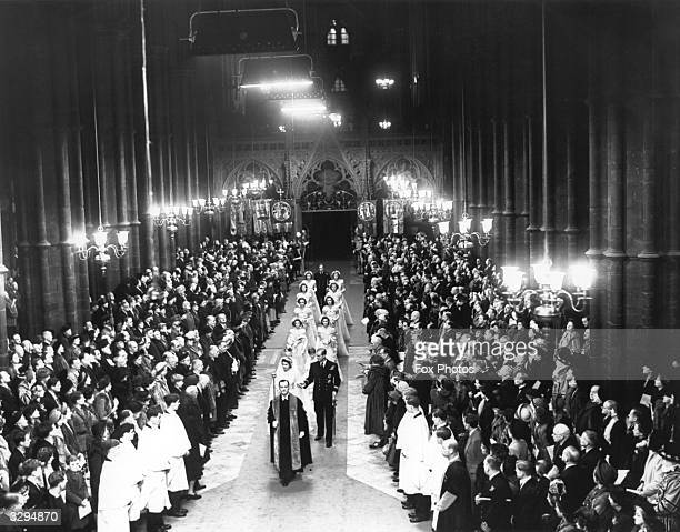 Queen Elizabeth II as Princess Elizabeth walks up the aisle of Westminster Abbey London with her father King George VI to marry the Duke of Edinburgh...