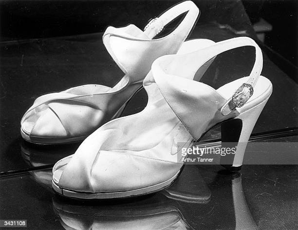 Shoes worn by Princess Elizabeth on her wedding day Ivory duchesse satin selflined they are in one piece embracing the waist of the foot with reverse...