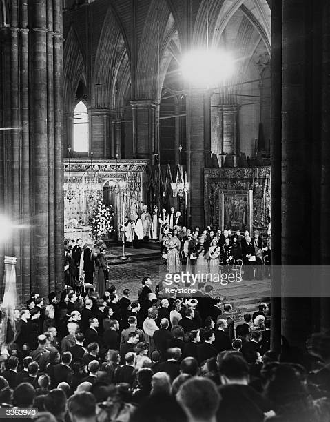 The Prince Philip Duke of Edinburgh waiting for his bride Princess Elizabeth with her parents King George VI and Queen Elizabeth at Westminster Abbey...