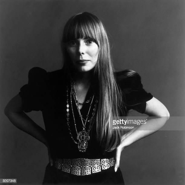 Portrait of American musician Joni Mitchell with her hands on her hips This image was from a photo shoot for the fashion magazine Vogue Mitchell...
