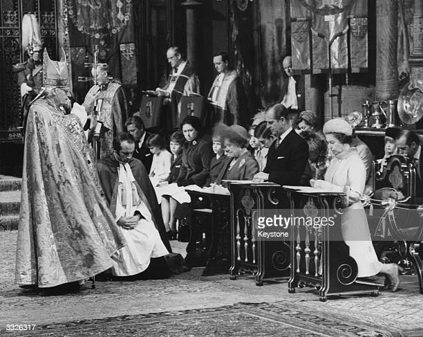 Archbishop of Canterbury Dr Arthur Ramsey blesses Queen Elizabeth II and Prince Philip the Duke of Edinburgh during a Service of Thanksgiving at...