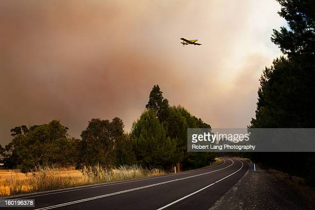 20th November 2012, Coomunga, Eyre Peninsula: A fully loaded Country Fire Service fixed winged water bombing plane flys over the Lincoln highway, a...