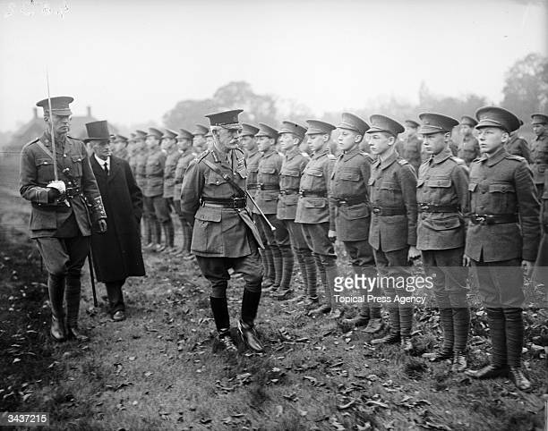 Sir H Smith-Dorien inspects members of the BTC at Dulwich College, an English public school in south-east London.