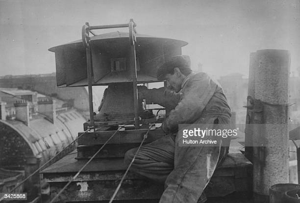 A technician adjusts one of the sirens in Paris' electric air raid warning system