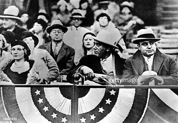 20th October 1931 Chicago gangster Al Capone is pictured enjoying a brief respite from his problems with the law as he watches a football match on a...