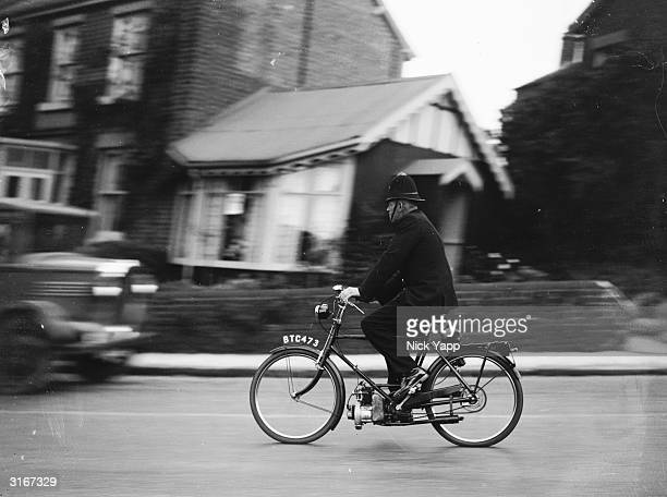 A policeman speeding along Garstang Road near Preston Lancashire on a new motor pedal cycle with a 98cc twostroke engine