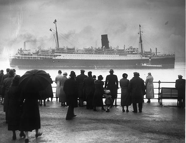 Crowds gather to see the 16,243 ton Cunard cruise liner...