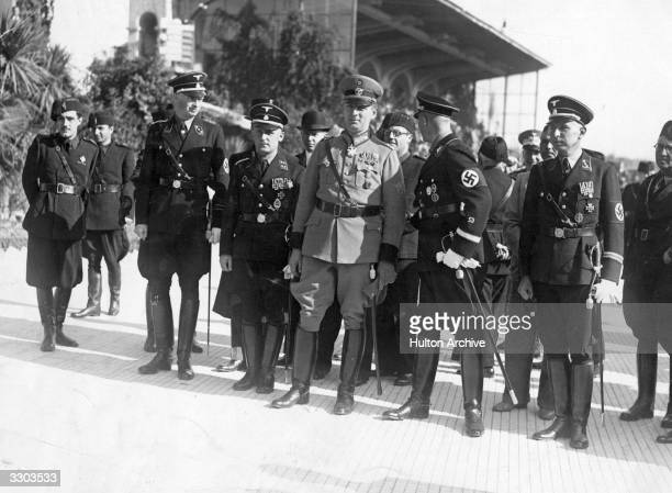 Reinhard Heydrich deputy Gestapo chief also known as 'The Hangman' seen here in the centre of a group of German Police officials during a visit to...