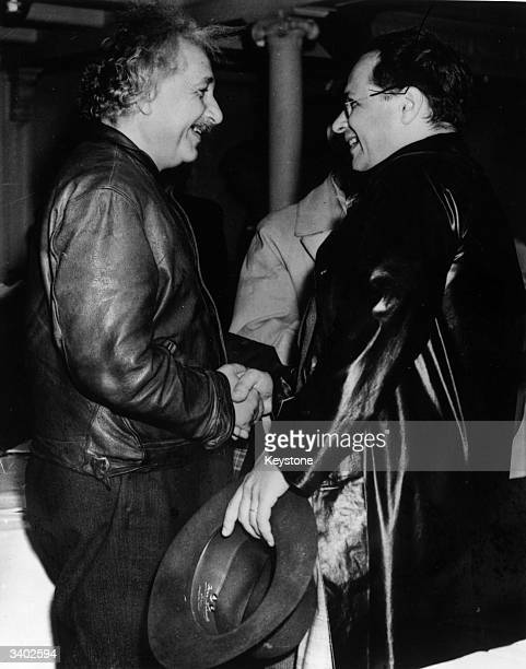 GermanSwissUS mathematical physicist Albert Einstein being greeted by his son Hans Albert on arrival at New York