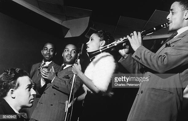 Maxine Sullivan in residency at the Onyx on 52nd Street singing with the John Kirby band New York City Left to right O'Neil Spencer Russell Procope...
