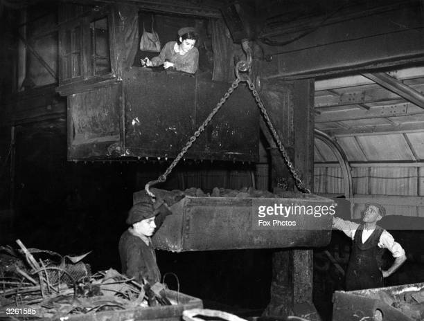 Mrs Mand Watson operating a travelling crane at the Park Gate Iron & Steel Company Limited, Rotherham.