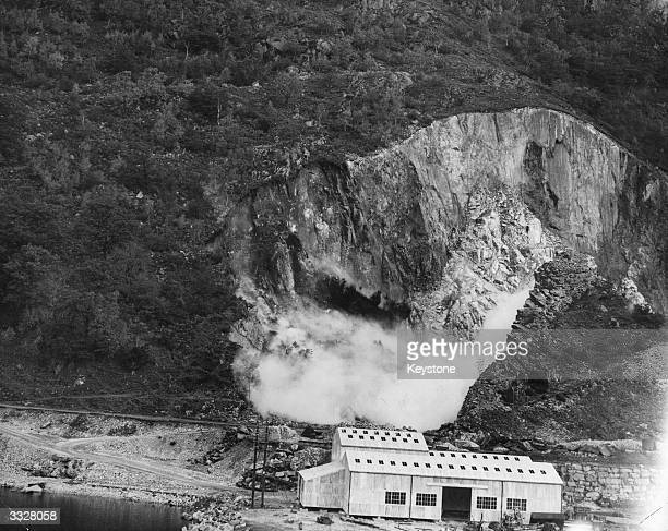 A quarter of a million tons of granite enough for five years' supply was dislodged by this one big blast at Bonawe Quarries Argyllshire Granite a...