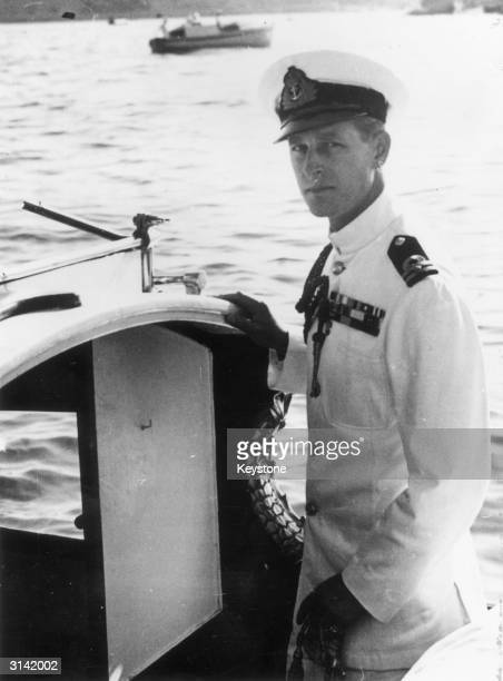 Prince Philip Duke of Edinburgh in naval uniform on a boat in Malta