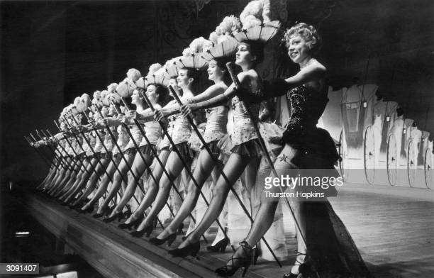 The chorus line from Emile Littler's hit West End show 'Zip Goes A Million' which stars George Formby as a Lancashire lad who makes it big Original...