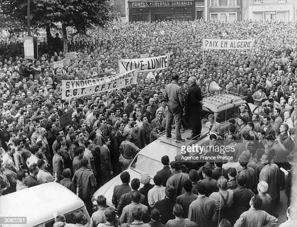 Workers from the Renault Car Company holding a meeting outside the Town Hall at Billancourt a suburb of Paris They are part of the ten thousand...