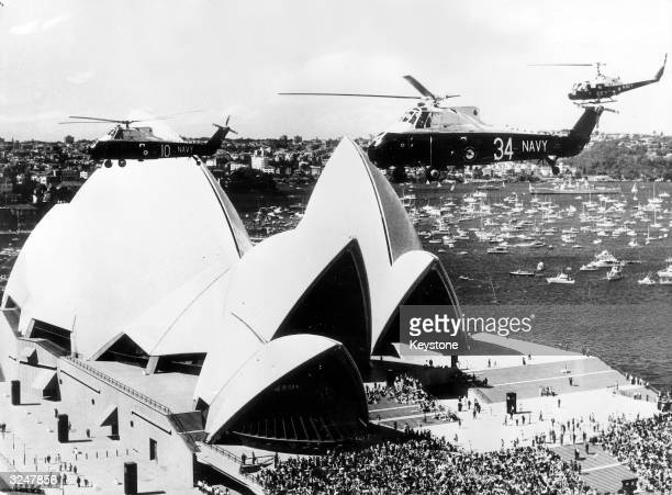Queen Elizabeth II officially opens the new Sydney Opera House designed by Danish architect Joern Utzon