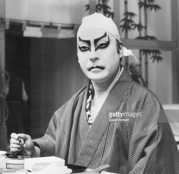 Ennosuke Ichikawa Japan's most distinguished exponent of the three hundred year old art form Kabuki Ichikawa prepares his costume and make up before...