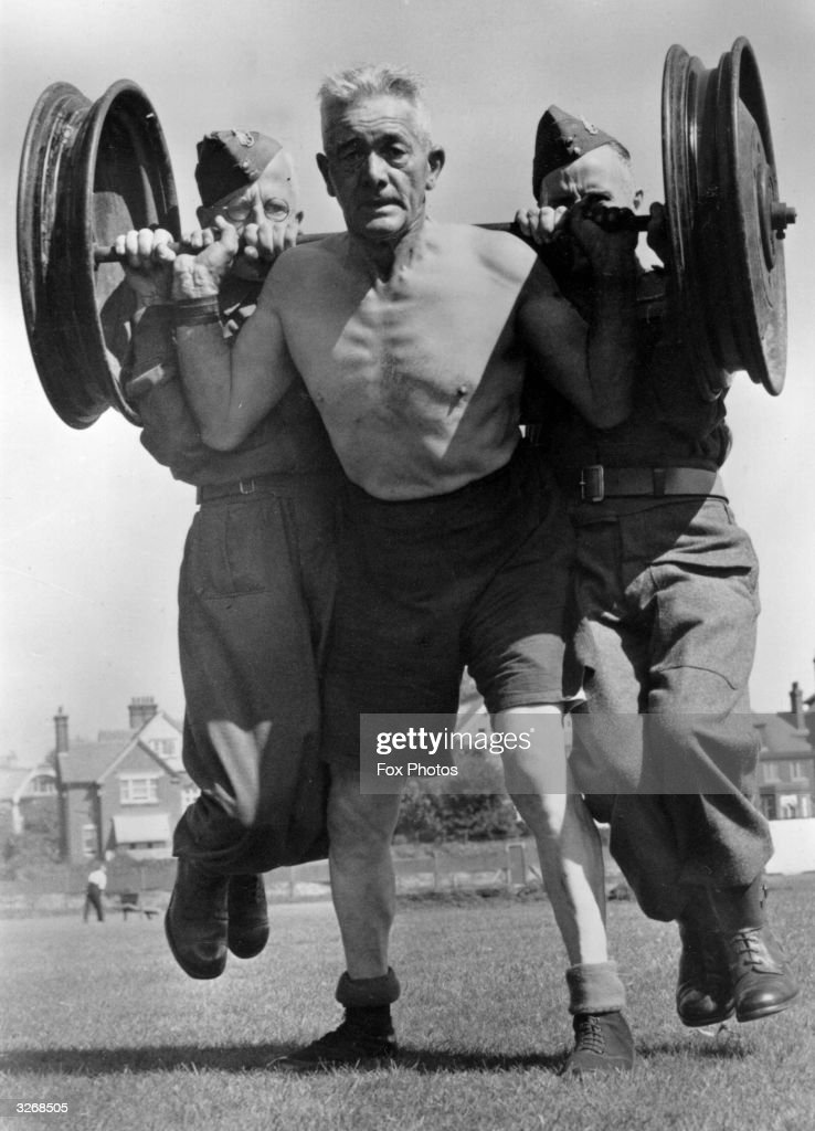 The total weight of the men and the weights borne by the physical training instructor to the local Home Guard is 39 stone. He himself weighs just over 11 stone and is 60 years of age.