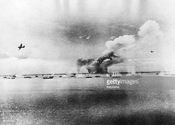 Japanese merchant ships lying at anchor in Manila Bay off the island of Luzon in the Philippines are caught in a surprise attack by US Navy Avenger...