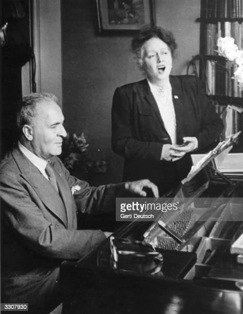 Germanborn US soprano Elisabeth Schumann rehearses with Germanborn US pianist and conductor Bruno Walter for the first Edinburgh Festival Original...