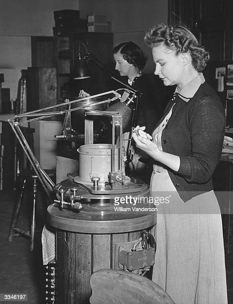 June Jones and G Harrod testing magnetic naval compasses at the Admiralty Compass Observatory in Slough, Buckinghamshire.