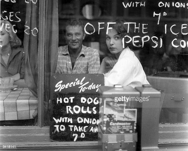 Richard Burton and Claire Bloom stars of 'Look Back in Anger' take a break from filming to grab a bite to eat in a cafe in London's East End